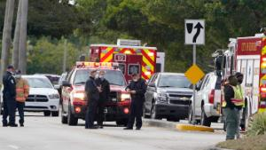 Law enforcement officers block an area where a shooting wounded several FBI while serving an arrest warrant, Tuesday, Feb. 2, 2021, in Sunrise, Florida.