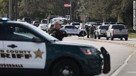 Law enforcement officers block off an area near where the agent deaths occurred in Sunrise, Florida.