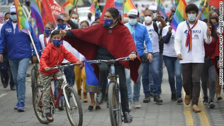 Pérez gives the thumbs up as he rides a bike during a campaign rally in Machachi, Ecuador, last month.