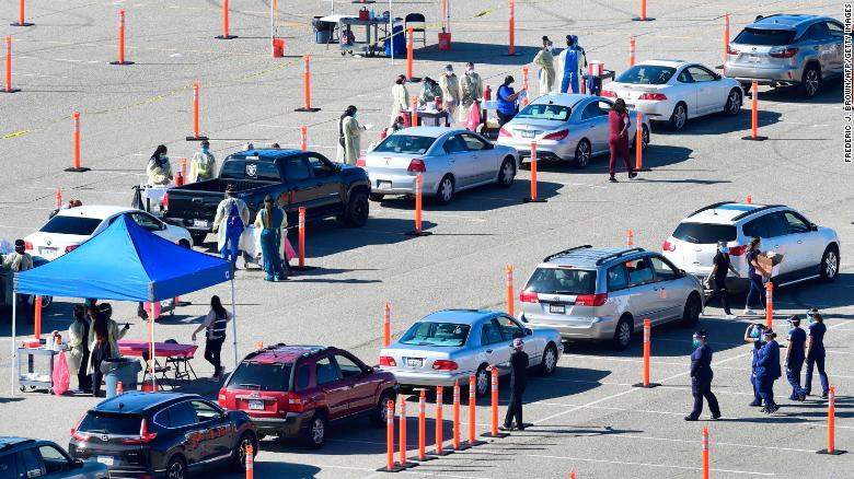 People arrive for their Covid-19 vaccine at the Auto Club Speedway in Fontana, California on February 2, 2021.