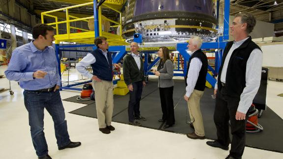 Bezos, third from left, meets with NASA Deputy Administrator Lori Garver at the Blue Origin headquarters in Kent, Washington, in 2011. Bezos' Blue Origin was started in 2000 with the goal of providing low-cost access to private space travel.