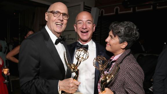 """Bezos joins """"Transparent"""" actor Jeffrey Tambor and director Jill Soloway after the Amazon Studios show won Emmys in 2016."""