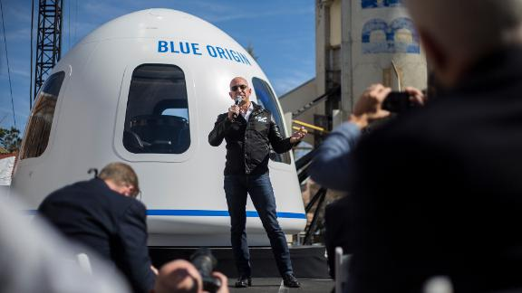 Bezos discusses his Blue Origin reusable rocket system in 2017. Reusable rockets would substantially reduce the cost of space flight.