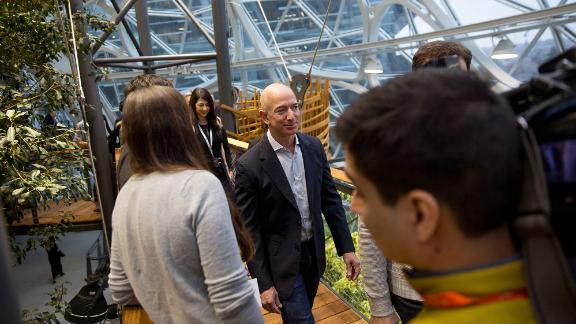 Bezos tours the Spheres, a gathering and working space for Amazon employees, at its opening ceremonies in Seattle in 2018. The space contains hundreds of plant species from cloud forest environments around the globe, and it maintains a tropical climate similar to Costa Rica or Indonesia.
