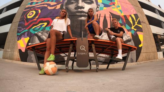 BellaTeq co-founders Carolyn Greco, Nancy Avesyan and Margaret Osmundson pose in front of a mural with a Teqball table in Los Angeles.