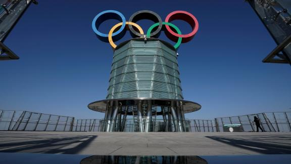 A security guard patrols at a viewing platform of the Olympics Tower in Beijing on Tuesday, Feb. 2, 2021. A coalition of 180 rights group on Wednesday called for a boycott of next year's Beijing Winter Olympics tied to reported human rights abuses against ethnic minorities in China. (AP Photo/Andy Wong)