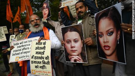 United Hindu Front activists hold placards of Swedish climate activist Greta Thunberg and Barbadian singer Rihanna during a demonstration in New Delhi on February 4, 2021.
