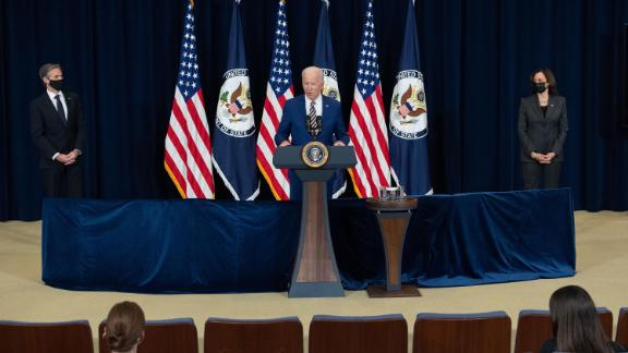 US President Joe Biden, with US Secretary of State Antony Blinken (L) and US Vice President Kamala Harris, speaks to the staff of the US State Department during his first visit in Washington, DC, February 4, 2021.