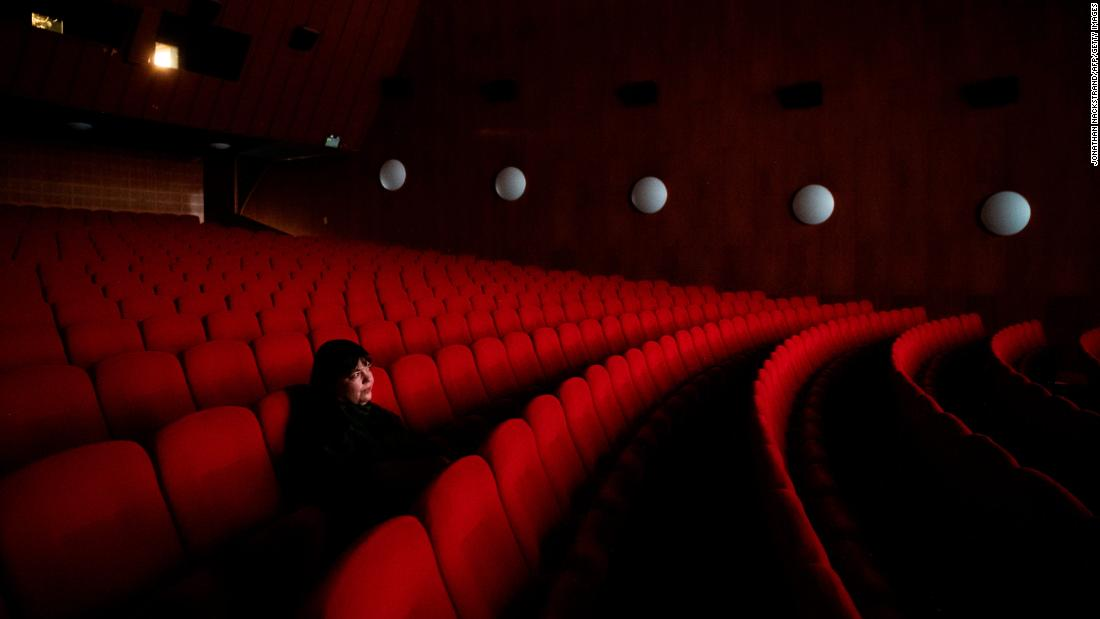 Sandra Fogel watches a movie alone January 30 during the Gothenburg Film Festival in Gothenburg, Sweden. Most fans watched the movies online this year. Fogel applied to be one of the few allowed to see a movie in person.