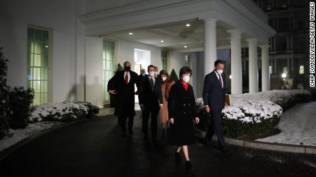 GOP Sens. Susan Collins and Mitt Romney lead a group of 10 fellow Republican senators out of the West Wing after meeting with President Joe Biden and Vice President Kamala Harris at the White House earlier this month.