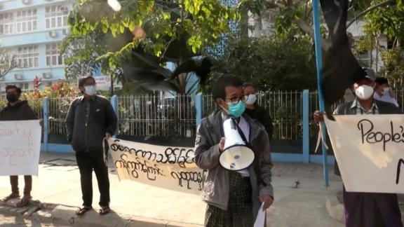 Days after the military coup in Myanmar, some protesters took to the streets with signs to peacefully demonstrate while health workers in hospitals across the capital Yangon threatened to go on strike.