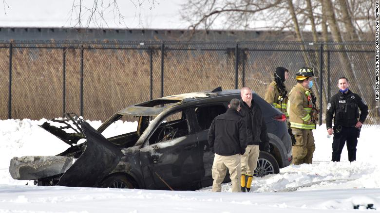 A man who was trying to get his SUV unstuck from a snowbank was killed when the vehicle caught fire