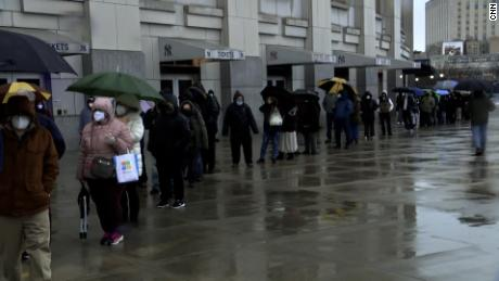 People line up for vaccines at New York's Yankee Stadium on Friday, the day its mass-inoculation site for Bronx residents debuted.