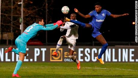 Nanu (center) goes for the ball as he collides with Kritsyuk (left).