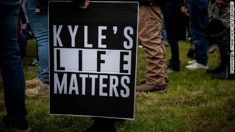 """A person holds a sign that reads """"Kyle's Life Matters,"""" a reference to Kyle Rittenhouse, as members of the Proud Boys and other similar groups gathered in Portland, Oregon on September 26, 2020."""