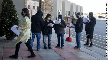 People wait in line at a senior care center on the Navajo Nation in Chinle, Arizona, to receive the Covid-19 vaccine on December 18, 2020.