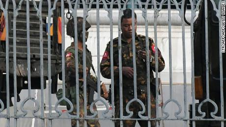 Soldiers keep watch inside the City Hall compound in Yangon on February 1, 2021.