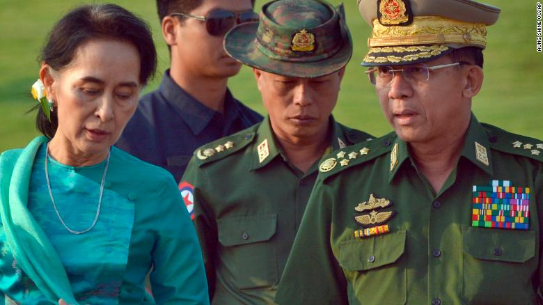 In this May 6, 2016, file photo, Aung San Suu Kyi, left, Myanmar's then foreign minister, walks with Senior Gen. Min Aung Hlaing, right, Myanmar military's commander in chief, in Naypyidaw.