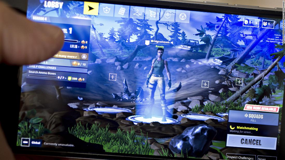 The Epic Games Inc. Fortnite: Battle Royale video game is displayed for a photograph on an Apple Inc. iPhone in Washington, D.C., U.S., on Thursday, May 10, 2018. Fortnite, the hitgamethat's denting the stock prices of video-gamemakers after signing up 45 million players, didn't really take off until it became free and a free-for-all.