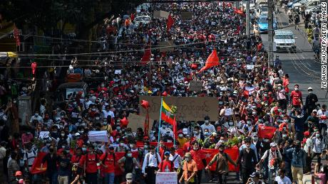 Protesters march during a demonstration against the military coup in Yangon on February 7, 2021.