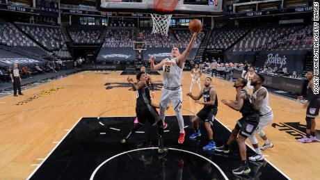 Jokic shoots during the game against the Sacramento Kings.