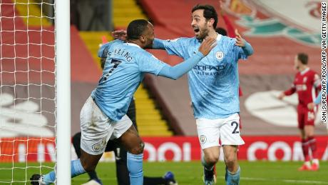 Sterling celebrates with Silva after scoring City's third goal.