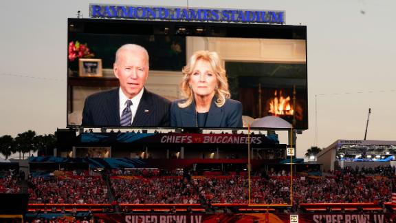 Fans at the stadium watch a pregame message from President Joe Biden and first lady Jill Biden.