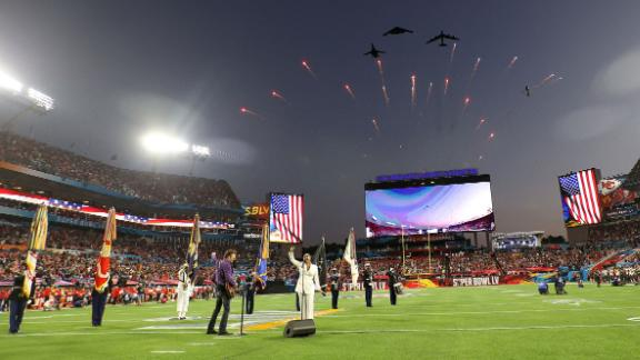 Jets fly over Raymond James Stadium as Eric Church and Jazmine Sullivan perform the National Anthem before the game.
