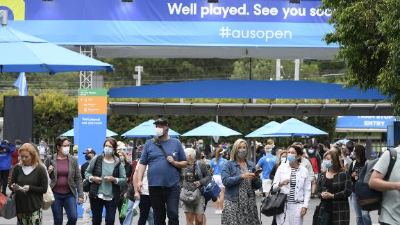 Spectators walk into Melbourne Park ahead of the first round matches at the Australian Open tennis championship in Melbourne, Australia, Monday, Feb. 8, 2021.(AP Photo/Andy Brownbill)