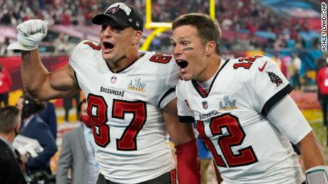 Rob Gronkowski and Tom Brady celebrating together after winning Super Bowl 55.