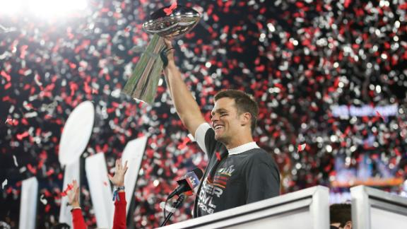Brady holds the Vince Lombardi Trophy after the game.