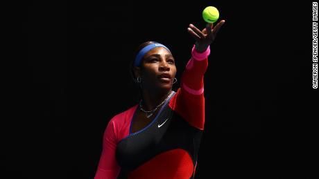 Serena Williams serves against Laura Siegemund at the Australian Open.