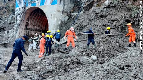 Rescue workers looking for 171 people feared dead in Uttarakhand after glacier burst