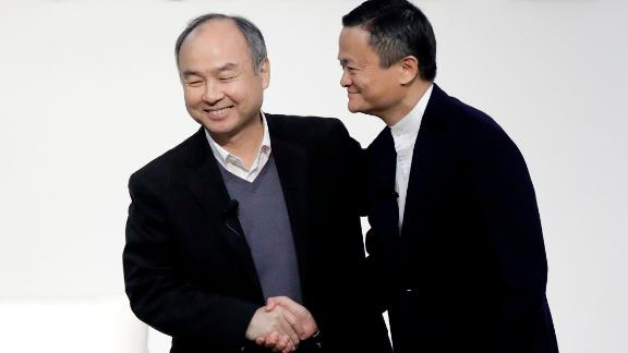Masayoshi Son, chairman and chief executive officer of SoftBank Group Corp., left, and Jack Ma, former chairman of Alibaba Group Holding Ltd., shake hands at Tokyo Forum 2019 in Tokyo, Japan, on Friday, Dec. 6, 2019. Sonunveiled a $184 million initiative Friday to accelerate artificial intelligence research in Japan, enlisting Ma to expound on his goal of commercializing the technology. Sons company announced a partnership with the University of Tokyo that includes spending 20 billion yen ($184 million) over 10 years by mobile arm SoftBank Corp. to establish theBeyond AI Institute. Photographer: Kiyoshi Ota/Bloomberg via Getty Images