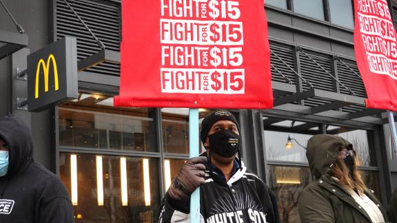 CHICAGO, ILLINOIS - JANUARY 15: Demonstrators participate in a  protest outside of McDonald's corporate headquarters on January 15, 2021 in Chicago, Illinois.  The protest was part of a nationwide effort calling for minimum wage to be raised to $15-per-hour. (Photo by Scott Olson/Getty Images)