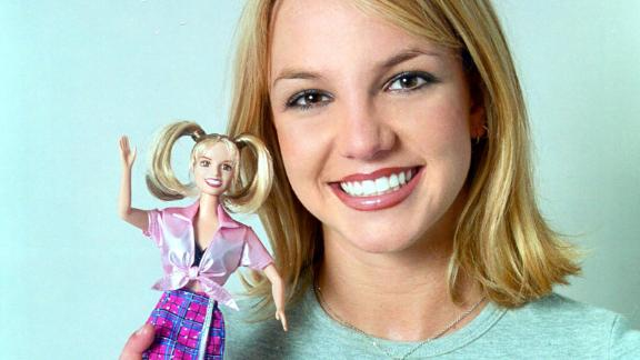Spears holds a doll of herself in 1999.