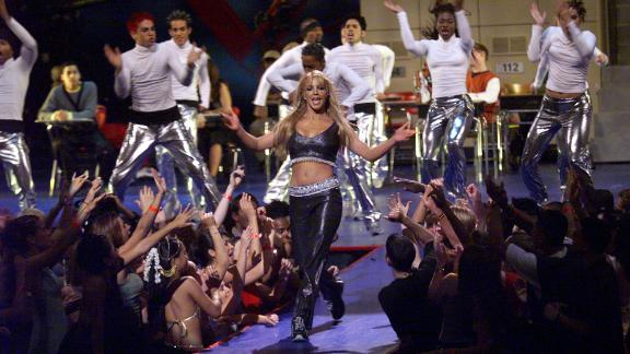 """Spears performs at the 1999 MTV Video Music Awards. Her first album """"...Baby One More Time,"""" had become a smash hit."""
