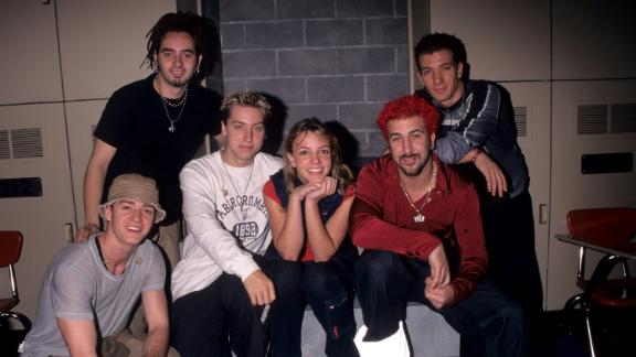 """Spears poses with the boy band NSYNC, who she once toured with, in 1999. NSYNC included her former """"Mickey Mouse Club"""" castmate Justin Timberlake, seen at bottom left."""