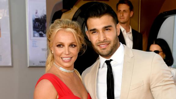 """Spears and her boyfriend Sam Asghari attend a Hollywood premiere in 2019. A couple of months earlier, she had checked out of a mental-health treatment facility after undertaking an """"all-encompassing wellness treatment."""""""