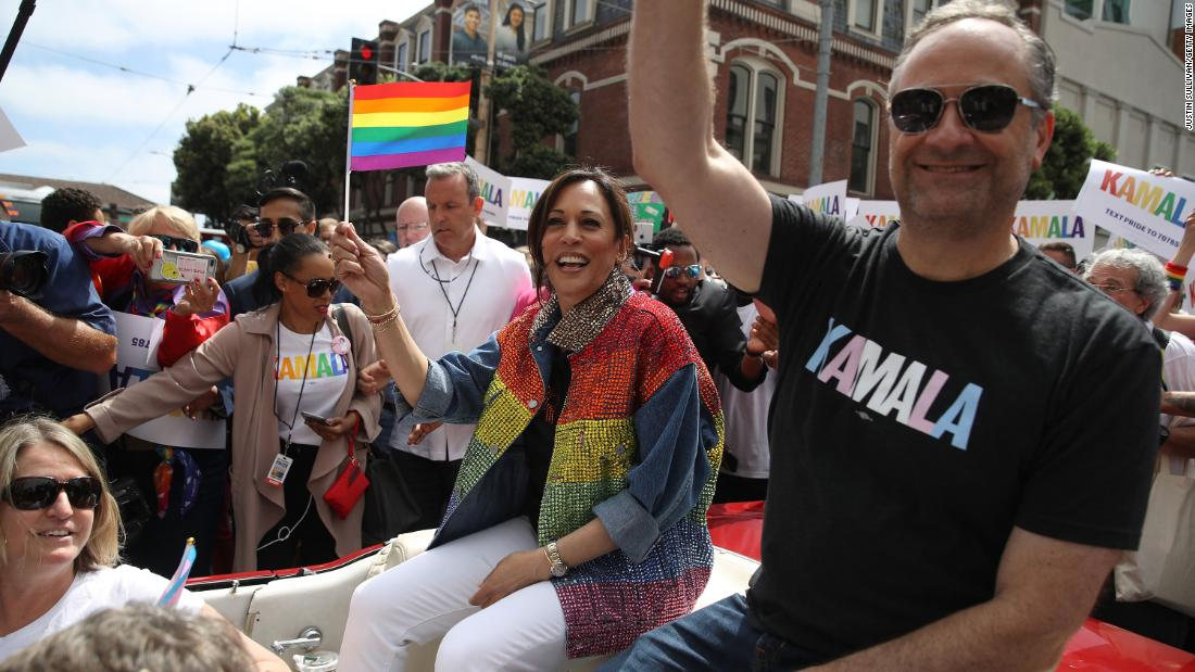 Then-Sen. Kamala Harris and husband Douglas Emhoff wave during the SF Pride Parade on June 30, 2019, in San Francisco.
