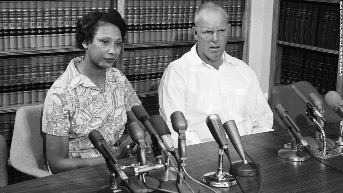 Mildred and Richard Loving answer questions at a press conference the day after the Supreme Court ruled in their favor in the Loving v. Virginia case in June 1967. The ruling held that laws banning interracial marriage were unconstitutional.