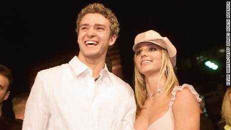 """Britney Spears (right) and then-boyfriend Justin Timberlake (left) arrive at the premiere of her movie """"Crossroads"""" at the Mann Chinese Theatre in Hollywood on February 11, 2002."""
