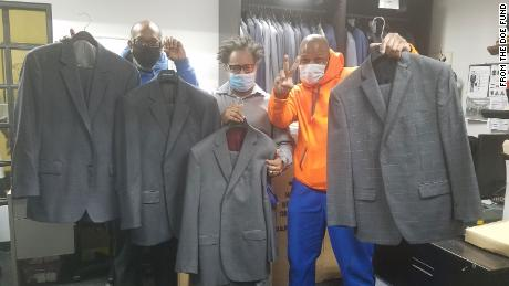 "Trainees from The Doe Fund's ""Ready, Willing & Able"" program receive the donated wardrobe items. From right are Michael Smith, Joseph Calhoun and George Thomas."