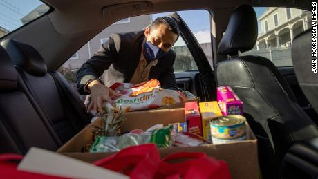 Community health worker Luis Hernandez delivers groceries to families with Covid-19 in Stamford, Connecticut.