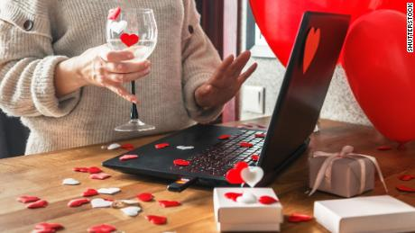 For Valentine's Day, set up a video call with your partner and celebrate with wine and a shared activity like painting.