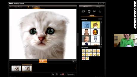 Thomas Smith demonstrates the kitten filter during an interview with CNN Business.
