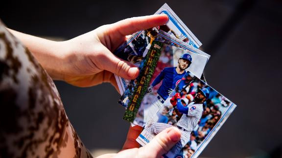 MESA, AZ - FEBRUARY 18:  A young fan plays with baseball cards of the Chicago Cubs during a workout after Photo Day on Tuesday, February 18, 2020 at Sloan Park in Mesa, Arizona.  (Photo by Adam Glanzman/MLB Photos via Getty Images)