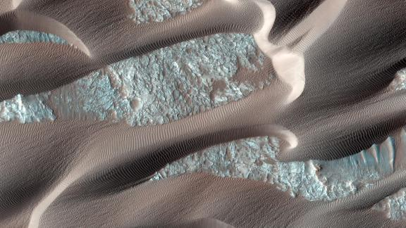 Mars is far from a flat, barren landscape. Nili Patera is a region on Mars in which dunes and ripples are moving rapidly. HiRISE, onboard the Mars Reconnaissance Orbiter, continues to monitor this area every couple of months to see changes over seasonal and annual time scales.