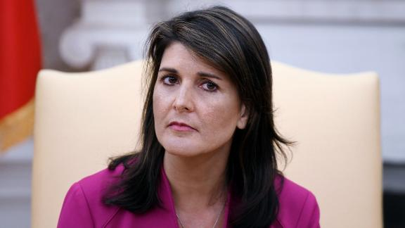 """Nikki Haley, the United States Ambassador to the United Nations looks on during a meeting with US President Donald Trump speaks in the Oval office of the White House October 9, 2018 in Washington, DC. - Nikki Haley resigned Tuesday as the US ambassador to the United Nations, in the latest departure from President Donald Trump's national security team. Meeting Haley in the Oval Office, Trump said that Haley had done a """"fantastic job"""" and would leave at the end of the year. (Photo by Olivier Douliery / AFP) (Photo by OLIVIER DOULIERY/AFP via Getty Images)"""