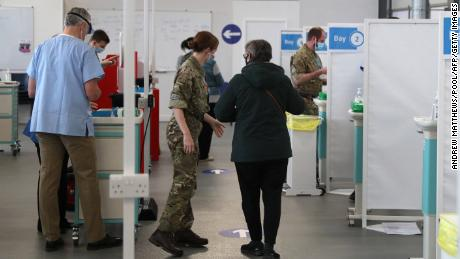 Temporary vaccination centers, like this one at Basingstoke Fire Station in southern England, have been set up across the country.